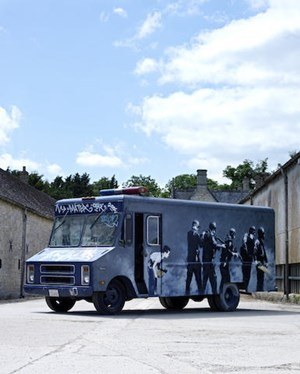 BANKSY'S SECRET SPRAY-PAINTED SWAT VAN STORMS TO AUCTION AT BONHAMS