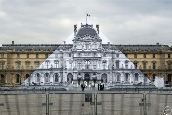 Famous artist JR makes the pyramid of the Louvre disappear